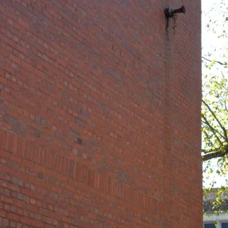 Bloomfield Awaits installation on building